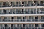 People stand on the balconies of their cabins, of a cruise ship that has been docked for almost two months due to the coronavirus outbreak at the port of Piraeus, near Athens, Wednesday, May 20, 2020. Greece's government says revenue from its vital tourism industry has been hammered as a result of the COVID-19 pandemic and lockdown measures, adding that detailed guidelines on how the season will operate will be announced Wednesday. (AP Photo/Thanassis Stavrakis)