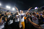 FILE - In this Nov. 30, 2019, file photo, LSU quarterback Joe Burrow (9) gestures thanks to the student section after playing his last game in Tiger Stadium, an NCAA college football game against Texas A&M, in Baton Rouge, La. Heading into this year's slate of conference title games a case could be made that No. 1 LSU (No. 2 CFP), No. 2 Ohio State (No. 1 CFP) and No. 3 Clemson (No. 3 CFP) have all done enough already to lose their conference championship games and still get in the College Football Playoff. (AP Photo/Gerald Herbert, File)