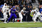 New Orleans Saints strong safety Vonn Bell (24) returns a fumble recovery as Minnesota Vikings tight end Kyle Rudolph (82) pursues in the first half of an NFL wild-card playoff football game, Sunday, Jan. 5, 2020, in New Orleans. (AP Photo/Brett Duke)