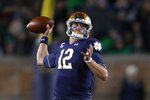 Notre Dame quarterback Ian Book throws against Southern California in the first half of an NCAA college football game in South Bend, Ind., Saturday, Oct. 12, 2019. (AP Photo/Paul Sancya)