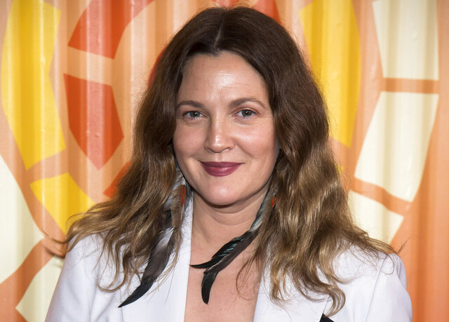 FILE - Drew Barrymore attends The Charlize Theron Africa Outreach Project fundraiser on Nov. 12, 2019, in New York. Barrymore's first show on Monday, Sept. 13, 2020, distributed by the CBS television studio, features former
