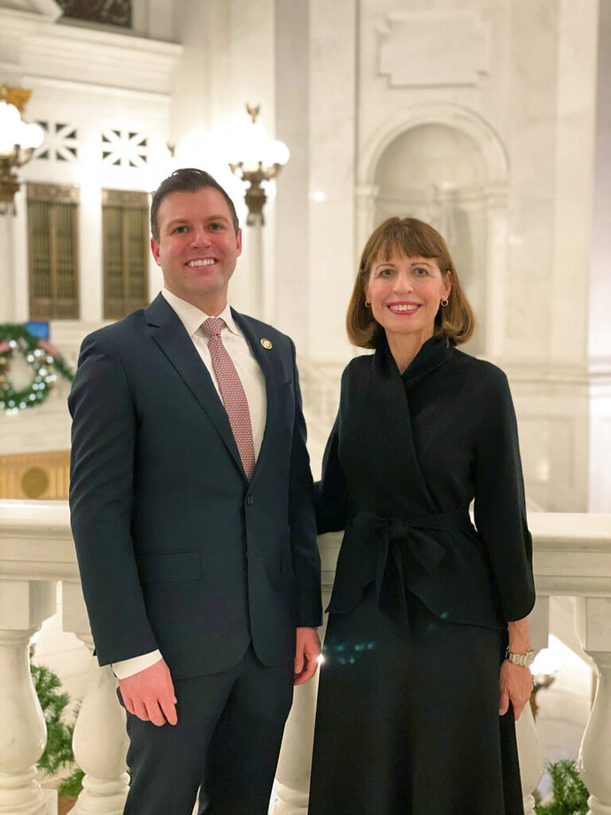 In this photo provided by Abby E. Chiumento, six-term Republican Rep. Ryan Mackenzie, left, and his mother Milou Mackenzie pose at the Capitol on Tuesday, Jan. 5, 2021, in Harrisburg, Pa. Milou Mackenzie was elected in November of 2020 as a state representative in an adjoining district as her son. She took the oath of office Tuesday. (Abby E. Chiumento via AP)