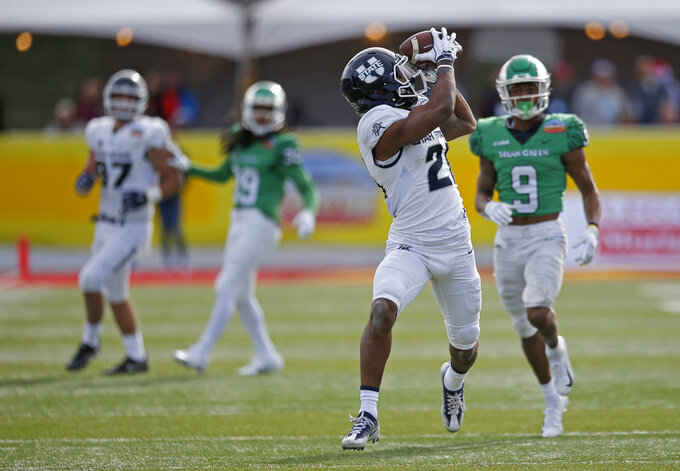 Utah State wide receiver Jalen Greene (21) catches a pass ahead of North Texas defensive back Nate Brooks (9) during the first half of the New Mexico Bowl NCAA college football game in Albuquerque, N.M., Saturday, Dec. 15, 2018. (AP Photo/Andres Leighton)