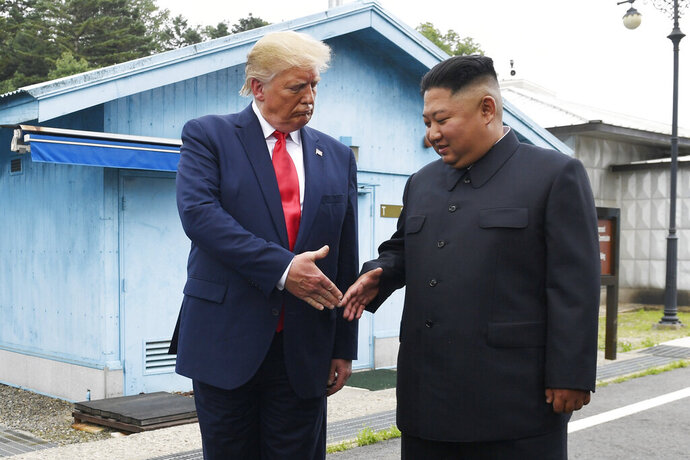 "FILE - In this June 30, 2019, file photo, U.S. President Donald Trump meets with North Korean leader Kim Jong Un at the border village of Panmunjom in the Demilitarized Zone, South Korea. North Korea has again insulted President Donald Trump, calling him a ""thoughtless and sneaky old man"" after he tweeted that North Korean leader Kim Jong Un wouldn't want to abandon a special relationship between the two leaders and affect the American presidential election by resuming hostile acts. (AP Photo/Susan Walsh, File)"