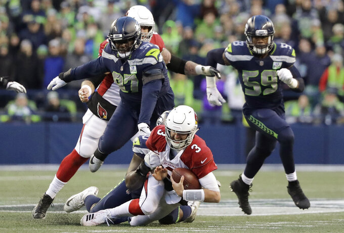 Arizona Cardinals quarterback Josh Rosen (3) is sacked by Seattle Seahawks' Jarran Reed during the second half of an NFL football game, Sunday, Dec. 30, 2018, in Seattle. (AP Photo/Ted S. Warren)