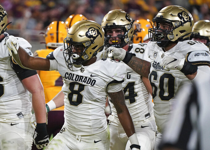 Colorado tailback Alex Fontenot (8) signals touchdown with his offensive tight end Matt Lynch (84) and lineman Jake Wiley (60) after scoring against Arizona State during the second half of an NCAA college football game Saturday Sept. 25, 2021, in Tempe, Ariz. (AP Photo/Darryl Webb)