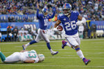 New York Giants running back Saquon Barkley (26) runs the ball into the end zone for a touchdown against the Miami Dolphins during the third quarter of an NFL football game, Sunday, Dec. 15, 2019, in East Rutherford, N.J. (AP Photo/Seth Wenig)