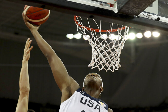 United States' Myles Turner prepares to dunk during a Group E match against Japan for the FIBA Basketball World Cup at the Shanghai Oriental Sports Center in Shanghai on Thursday, Sept. 5, 2019. (AP Photo/Ng Han Guan)