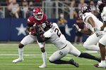 Arkansas running back Trelon Smith, left, is stopped by Texas A&M defensive lineman Micheal Clemons (2) on a carry in the second half of an NCAA college football game in Arlington, Texas, Saturday, Sept. 25, 2021. (AP Photo/Tony Gutierrez)