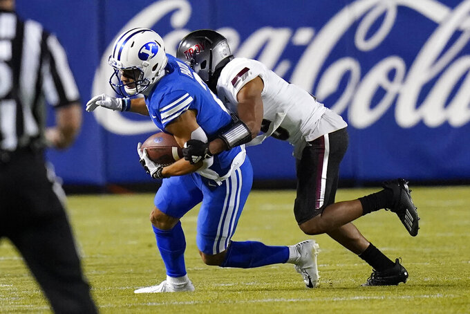 Troy cornerback Reddy Steward, right, tackles BYU wide receiver Neil Pau'u during the first half of an NCAA college football game Saturday, Sept. 26, 2020, in Provo, Utah. (AP Photo/Rick Bowmer, Pool)