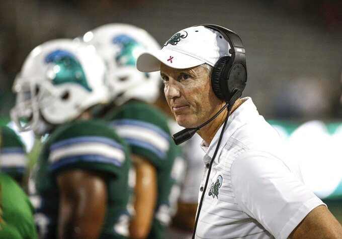 "File-This Oct. 21, 2018, file photo shows Tulane head coach Willie Fritz on the sideline during an NCAA college football game against South Florida in New Orleans, La. One year after coming up a yard short of bowl eligibility, Tulane aims to avoid cutting it so close this time. The Green Wave needs a victory over visiting Navy on Saturday, Nov. 24, 2018, to reach the six-victory plateau, which would virtually assure Tulane its first bowl bid since the 2013 season and only its third since 2002. ""We've increased our conference wins. Getting to a bowl game would be big for us,"" third-year Tulane coach Willie Fritz said.  (AP Photo/Derick E. Hingle, File)"