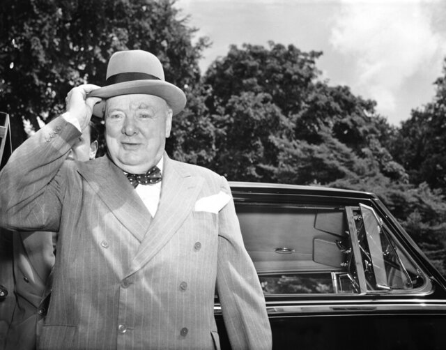 "FILE - In this June 29, 1954 file photo, British Prime Minister Winston Churchill holds his hat as he arrives at the White House in Washington. Newly public document reveal that former British Prime Minister John Major was interested in renaming Heathrow Airport after wartime leader Winston Churchill but never moved forward on the idea. Documents released Tuesday, Dec. 31, 2019 show that Major considered the idea in 1996 after receiving a letter urging him to drop the ""stupid"" name of Heathrow from the UK's busiest airport. (AP Photo/Charles Gorry, file)"