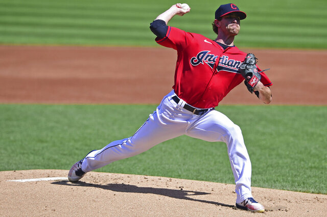 Cleveland Indians starting pitcher Shane Bieber delivers during the first inning of a baseball game against the Milwaukee Brewers, Sunday, Sept. 6, 2020, in Cleveland. (AP Photo/David Dermer)