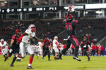 San Diego State safety Trenton Thompson (18) intercepts a pass during the first half of an NCAA football game against New Mexico Saturday, Oct. 9, 2021, in Carson, Calif. (AP Photo/Ashley Landis)