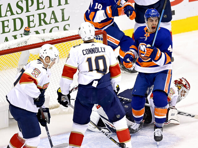 New York Islanders defenseman Andy Greene (4) celebrates a goal by teammate Jean-Gabriel Pageau, not pictured, as Florida Panthers right wing Brett Connolly (10) and teammates Frank Vatrano (77) and goaltender Sergei Bobrovsky (72) look on during the first period of an NHL Stanley Cup playoff hockey game in Toronto, Saturday, Aug. 1, 2020. (Frank Gunn/The Canadian Press via AP)