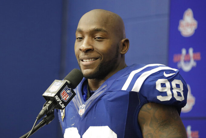 FILE - In this Jan. 1, 2017, file photo, Indianapolis Colts linebacker Robert Mathis speaks during a news conference following an NFL football game against the Jacksonville Jaguars in Indianapolis. Mathis, the Indianapolis Colts career sacks leader, will be inducted into the Indianapolis Colts Ring of Honor later this year. The ceremony will take place at halftime of its Nov. 28 game against Super Bowl champion Tampa Bay. Team officials announced the rescheduled event Monday, May 17, 2021. Mathis was supposed to become the 17th honoree last season but the induction was postponed because of the COVID-19 pandemic. (AP Photo/Darron Cummings, File)