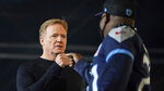NFL Commissioner Roger Goodell fist bumps a Tennessee Titans fan after the start of the fourth round of the NFL football draft, Saturday, May 1, 2021, in Cleveland. (AP Photo/Tony Dejak)