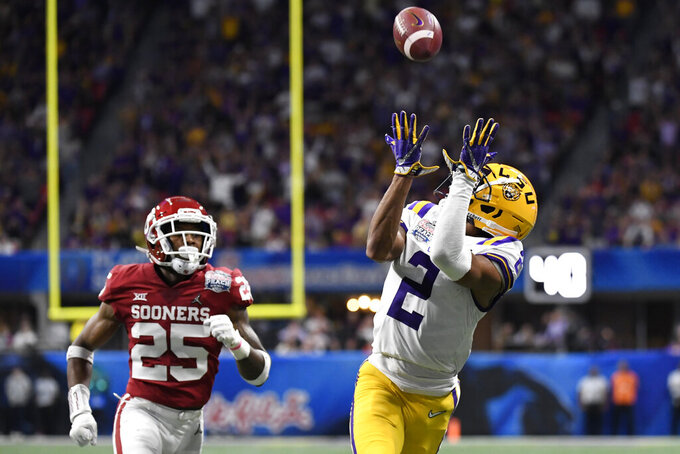 LSU wide receiver Justin Jefferson (2) prepares for a touchdown catch against Oklahoma safety Justin Broiles (25) during the first half of the Peach Bowl NCAA semifinal college football playoff game, Saturday, Dec. 28, 2019, in Atlanta. (AP Photo/Danny Karnik)