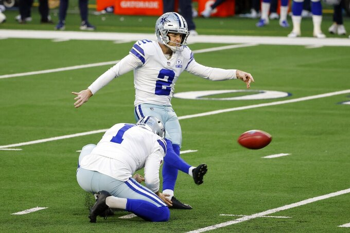 Dallas Cowboys' Hunter Niswander (1) holds as Greg Zuerlein (2) kicks a field goal in the second half of an NFL football game against the San Francisco 49ers in Arlington, Texas, Sunday, Dec. 20, 2020. (AP Photo/Michael Ainsworth)