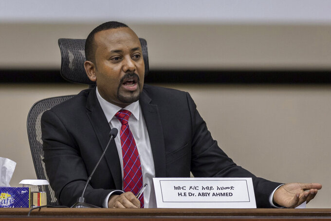 FILE - In this Monday, Nov. 30, 2020 file photo, Ethiopia's Prime Minister Abiy Ahmed responds to questions from members of parliament at the prime minister's office in the capital Addis Ababa, Ethiopia. Ethiopia has again delayed its national election after the head of the national elections board, Birtukan Mideksa, in a meeting with political parties' representatives on Saturday, May 15, 2021 said the June 5 vote in Africa's second most populous country would be postponed until a yet-unknown date. (AP Photo/Mulugeta Ayene, File)