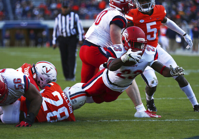 Liberty running back Frankie Hickson (23) dives over the goal line for a touchdown in the first half  of an NCAA college football game against Virginia  Saturday, Nov. 10, 2018, in Charlottesville, Va. (Zack Wajsgras /The Daily Progress via AP)