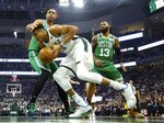 Milwaukee Bucks' Giannis Antetokounmpo tries to drive past Boston Celtics' Al Horford during the first half of Game 2 of a second round NBA basketball playoff series Tuesday, April 30, 2019, in Milwaukee. (AP Photo/Morry Gash)