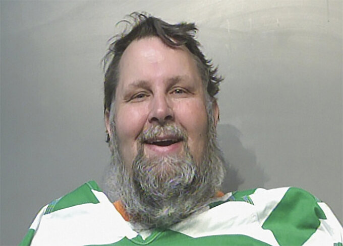 """In this March 1, 2021, booking photo, Harvey Hunter Jr. is shown in at the Polk County Jail in Des Moines, Iowa after turning himself in to face a charge of first-degree harassment. Hunter is defending a profane voicemail he left for Iowa Gov. Kim Reynolds that said she should be """"hung for treason,"""" saying he didn't intend to threaten her and was expressing his opposition to her COVID-19 restrictions. (Polk County Jail via AP)"""