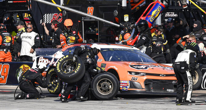 Landon Cassill's (00) pit crew services his car during a NASCAR auto race at Texas Motor Speedway, Sunday, Nov. 3, 2019, in Fort Worth, Texas. (AP Photo/Larry Papke)