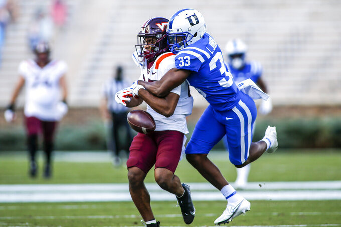 Duke cornerback Leonard Johnson (33) breaks up a pass intended for Virginia Tech wide receiver Tayvion Robinson (83) during the first half of an NCAA college football game, Saturday, Oct. 3, 2020, in Durham, N.C.  (Nell Redmond/Pool Photo via AP)