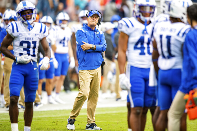 Duke head coach David Cutcliffe looks on during a timeout in the second quarter of an NCAA college football game against Virginia at Scott Stadium on Saturday, Oct. 16, 2021, in Charlottesville, Va. (AP Photo/Mike Caudill)