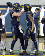 California running back Patrick Laird, left, is congratulated by wide receiver Nikko Remigio after scoring against Colorado during the first half of an NCAA college football game in Berkeley, Calif., Saturday, Nov. 24, 2018. (AP Photo/Jeff Chiu)