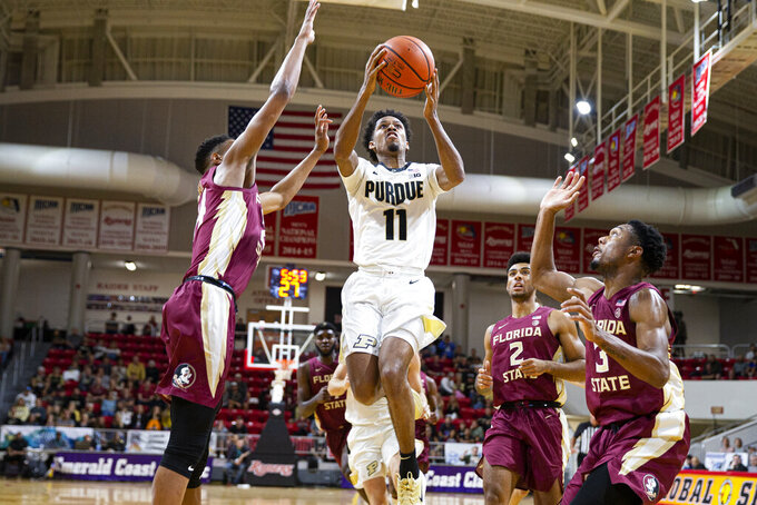 Purdue guard Isaiah Thompson (11) goes up for a shot against Florida State in the first half of an NCAA college basketball game at the Emerald Coast Classic in Niceville, Fla., Saturday, Nov. 30, 2019. (AP Photo/Mark Wallheiser)