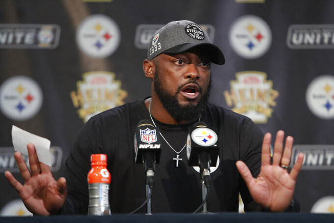 Pittsburgh Steelers head coach Mike Tomlin talks with reporters following a 27-3 win over the Cincinnati Bengals in an NFL football game in Pittsburgh, Monday, Sept. 30, 2019. (AP Photo/Tom E. Puskar)