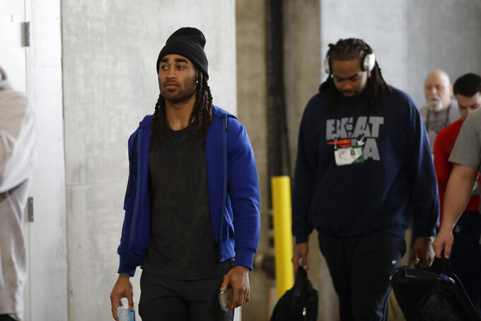 New England Patriots' Stephon Gilmore arrives for a NFL football walkthrough, Saturday, Feb. 2, 2019, in Atlanta, ahead of Super Bowl 53 against the Los Angeles Rams. (AP Photo/Matt Rourke)