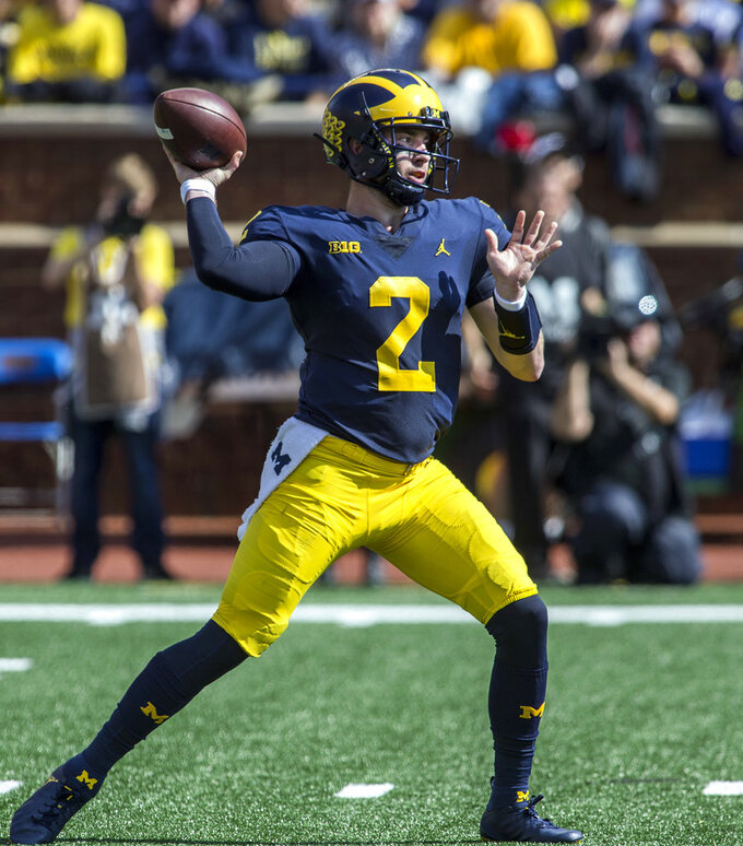 Michigan quarterback Shea Patterson (2) throws a pass in the first quarter of an NCAA college football game against Maryland in Ann Arbor, Mich., Saturday, Oct. 6, 2018. (AP Photo/Tony Ding)