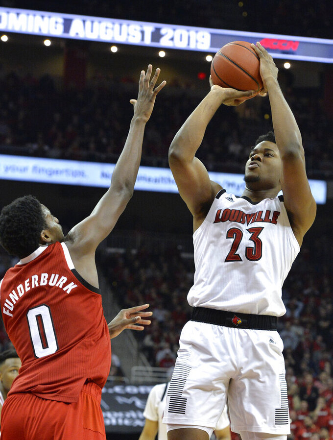 Louisville center Steven Enoch (23) shoots over North Carolina State forward DJ Funderburk (0) during the second half of an NCAA college basketball game in Louisville, Ky., Thursday, Jan. 24, 2019. Louisville won 84-77. (AP Photo/Timothy D. Easley)