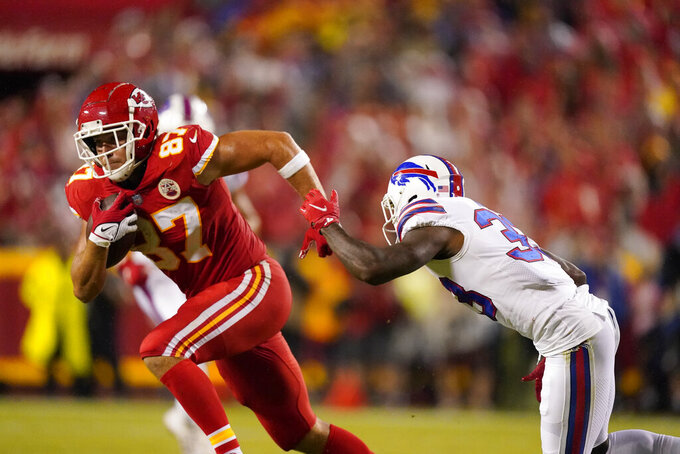 Kansas City Chiefs tight end Travis Kelce, left, catches a pass as Buffalo Bills cornerback Siran Neal defends during the first half of an NFL football game Sunday, Oct. 10, 2021, in Kansas City, Mo. (AP Photo/Charlie Riedel)