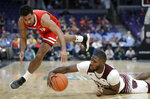 Bradley's Dwayne Lautier-Ogunleye, left, and Missouri State's Kabir Mohammed dive after the ball during the first half of an NCAA college basketball game in the quarterfinal round of the Missouri Valley Conference tournament, Friday, March 8, 2019, in St. Louis. (AP Photo/Jeff Roberson)