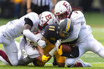Appalachian State's Jalen Virgil is brought down by Elon's Shamari Wingard (9), Nick Veloz (54) and Cole Coleman during the second quarter of an NCAA college football game, Saturday, Sept. 18, 2021, at Kidd Brewer Stadium in Boone, N.C. (Kenneth Ferriera/News & Record via AP)