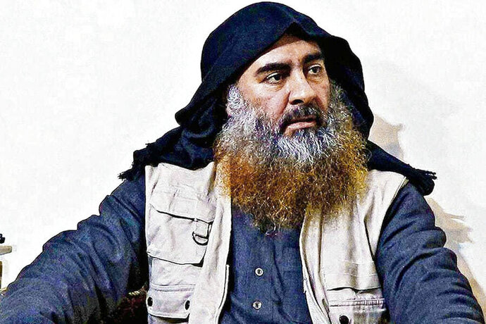 FILE - This file image released by the Department of Defense on Wednesday, Oct. 30, 2019, and displayed at a Pentagon briefing, shows an image of Islamic State leader Abu Bakr al-Baghdadi. The Islamic State group seemed largely defeated last year, with the loss of its territory, the killing of its founder in a U.S. raid and an unprecedented crackdown on its social media propaganda machine but tensions between the U.S. and Iran in the region provide a comeback opportunity for the extremist group. (Department of Defense via AP, File)