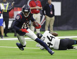 Houston Texans wide receiver DeAndre Hopkins (10) runs past Jacksonville Jaguars middle linebacker Myles Jack (44) after making a catch during the first half of an NFL football game, Sunday, Dec. 30, 2018, in Houston. (AP Photo/David J. Phillip)