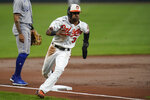 Baltimore Orioles' Cedric Mullins runs the bases before scoring on a single by Anthony Santander against the Kansas City Royals during the first inning of a baseball game, Tuesday, Sept. 7, 2021, in Baltimore. (AP Photo/Julio Cortez)