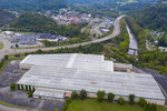 This aerial photo taken with a drone shows the former furniture manufacturing building, Friday Sept. 18, 2020, in St. Paul, Va. The building was expected to house a proposed biofuels business that got public economic development money. The project, Appalachian Biofuels, never materialized and part of the part of the developer's grant that was supposed to be repaid was instead forgiven. (AP Photo/Steve Helber)