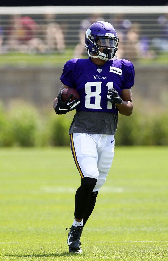 Minnesota Vikings wide receiver Olabisi Johnson carries the ball during the NFL football team's training camp Monday, July 29, 2019, in Eagan, Minn. (AP Photo/Jim Mone)