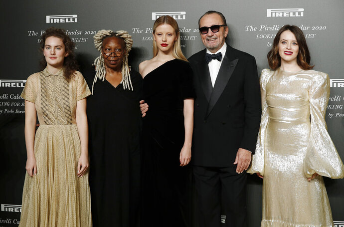 From left, Stella Roversi, American actress Whoopi Goldberg, British model Mia Goth, Italian photographer Paolo Roversi and British actress Claire Foy pose for photographers at the 2020 Pirelli Calendar event in Verona, Italy, Tuesday, Dec. 3, 2019. (AP Photo/Antonio Calanni)