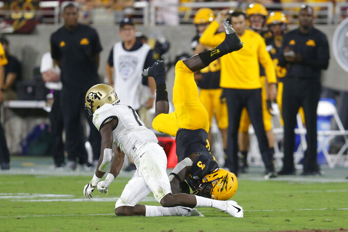 Colorado cornerback Delrick Abrams Jr. upends Arizona State running back Eno Benjamin (3) during the first half of an NCAA college football game Saturday, Sept. 21, 2019, in Tempe, Ariz. (AP Photo/Rick Scuteri)