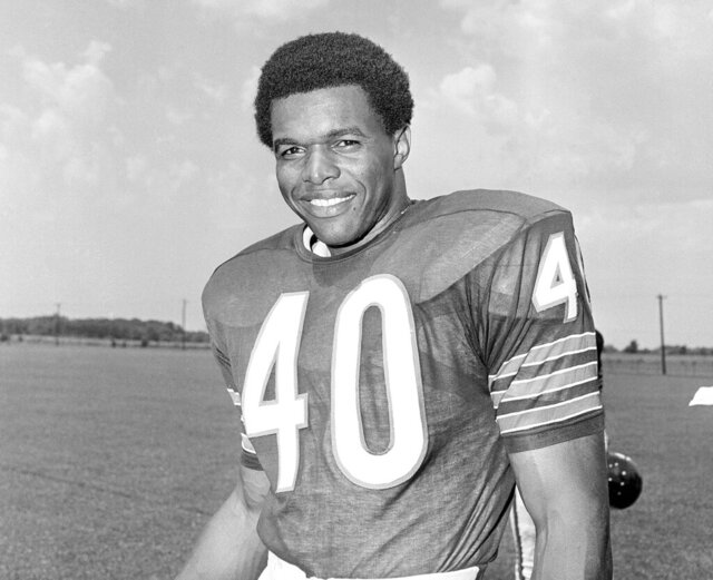 "FILE - This is a 1970 file photo showing Chicago Bears football player Gale Sayers. Hall of Famer Gale Sayers, who made his mark as one of the NFL's best all-purpose running backs and was later celebrated for his enduring friendship with Chicago Bears teammate Brian Piccolo, has died. He was 77. Nicknamed ""The Kansas Comet"" and considered among the best open-field runners the game has ever seen, Sayers died Wednesday, Sept. 23, 2020, according to the Pro Football Hall of Fame. (AP Photo/File)"