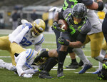 Oregon's CJ Verdell dives into the end zone for a third-quarter score against UCLA in an NCAA college football game Saturday, Nov. 21, 2020, in Eugene, Ore. (AP Photo/Chris Pietsch)