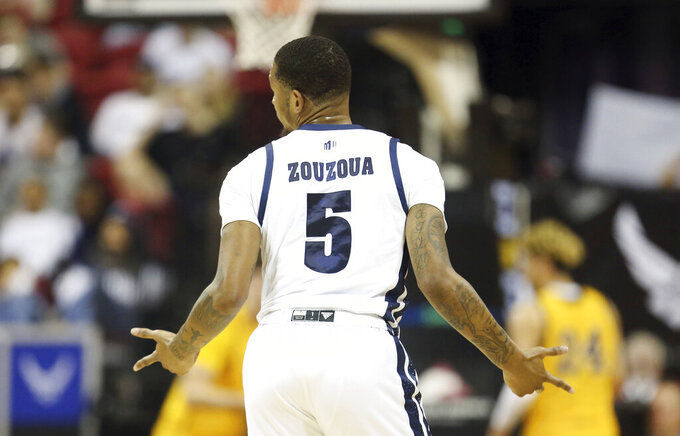 Nevada's Nisre Zouzoua reacts after sinking a 3-point shot during the first half of the team's Mountain West Conference tournament NCAA college basketball game against Wyoming on Thursday, March 5, 2020, in Las Vegas. (AP Photo/Isaac Brekken)