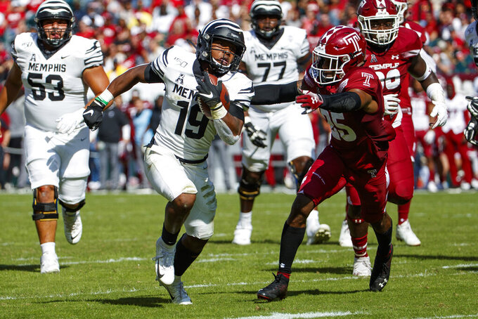 Memphis running back Kenneth Gainwell (19) runs for a touchdown as Temple safety Amir Tyler (25) reaches for him during an NCAA college football, Saturday, Oct. 12, 2019, in Philadelphia. (AP Photo/Chris Szagola)